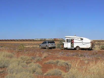 End of dirt road camp site near iron ore railway