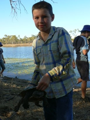 Thomas catches a turtle in the lagoon