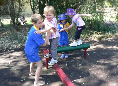 Hugh assisted by Connor on the balance beam