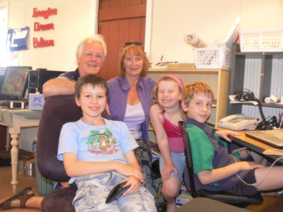 John and Judy with Thomas, Sophia and Connor in the school room